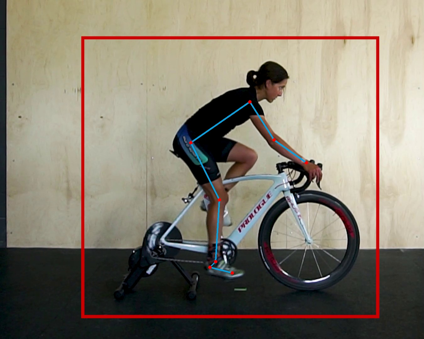 Cyclist getting a bike fit with leg at 180 degrees